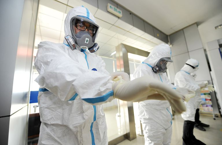 Quarantine officers attend an exercise to prevent Ebola virus at Zhangjiajie Hehua International Airport.