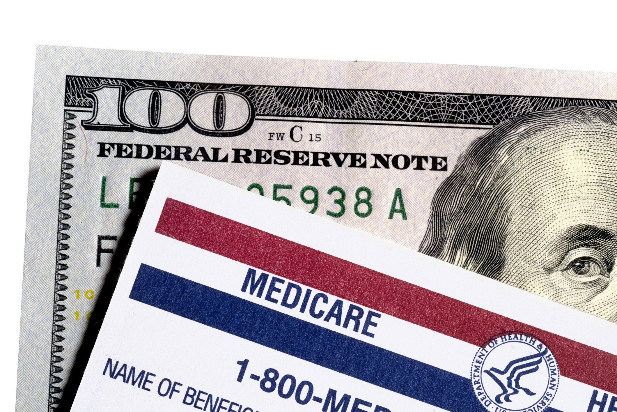 100 dollar bill and medicare form