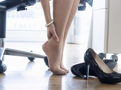 A woman suffering from high heel-related pain.
