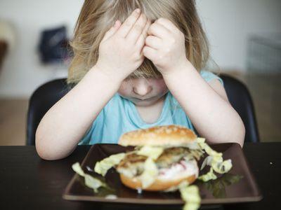 upset child with food