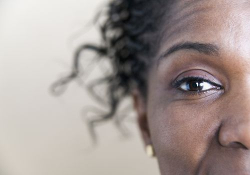 Close up of half of a Black woman's face, focused on her eye.