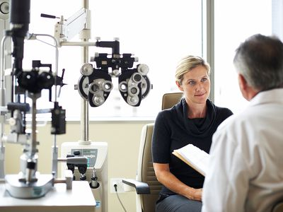 Patient speaking with eye doctor