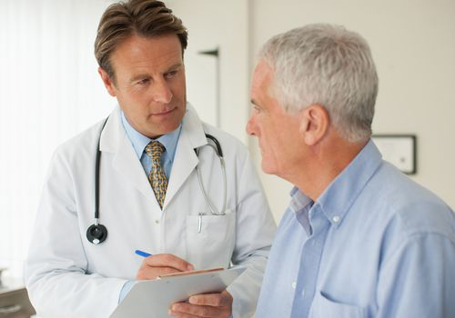 doctor talking with older male patient