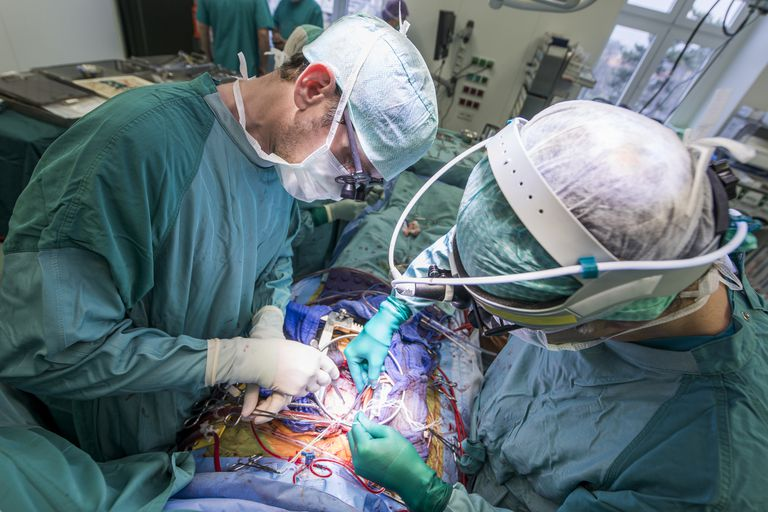 Heart surgeons during a heart valve operation