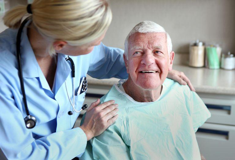 Doctor comforts patient.
