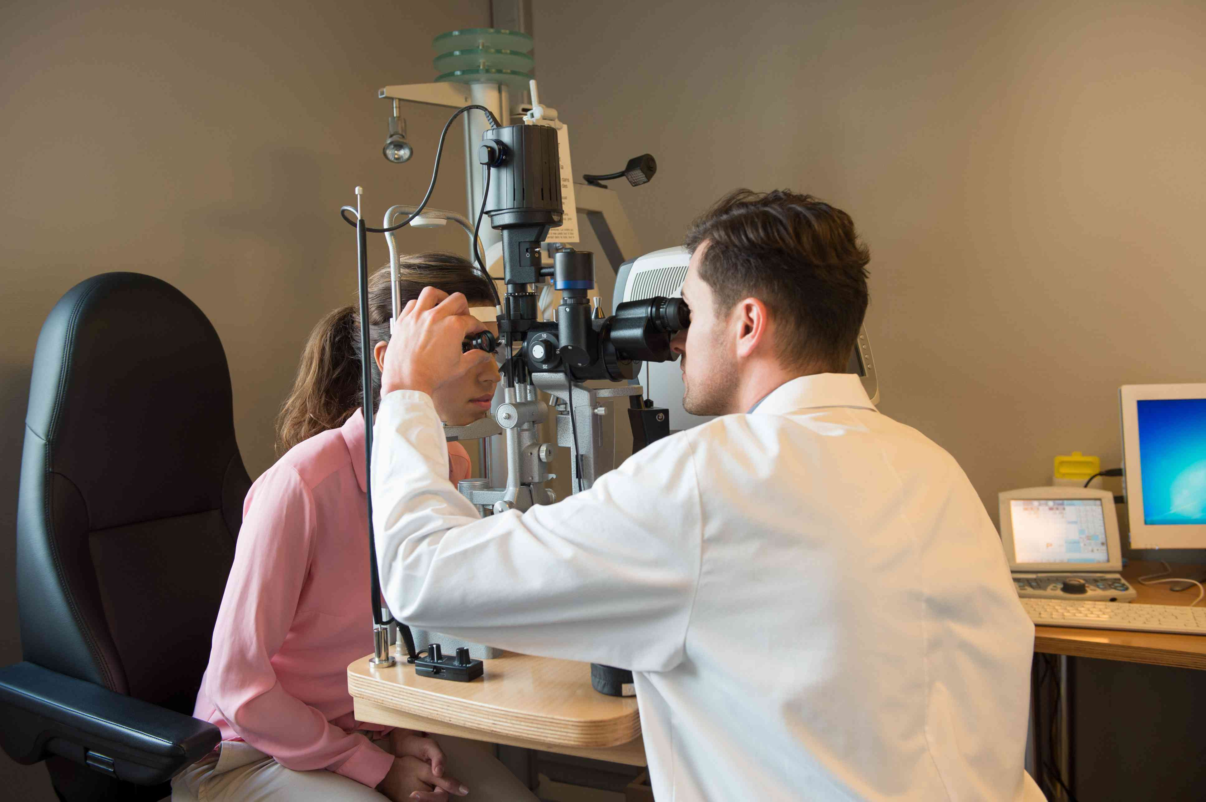 Doctor examining the eye for floaters.