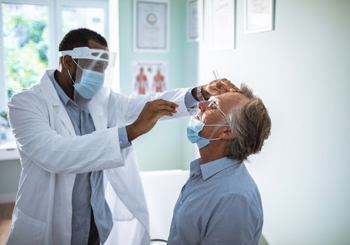 Man having a nasal swab test.