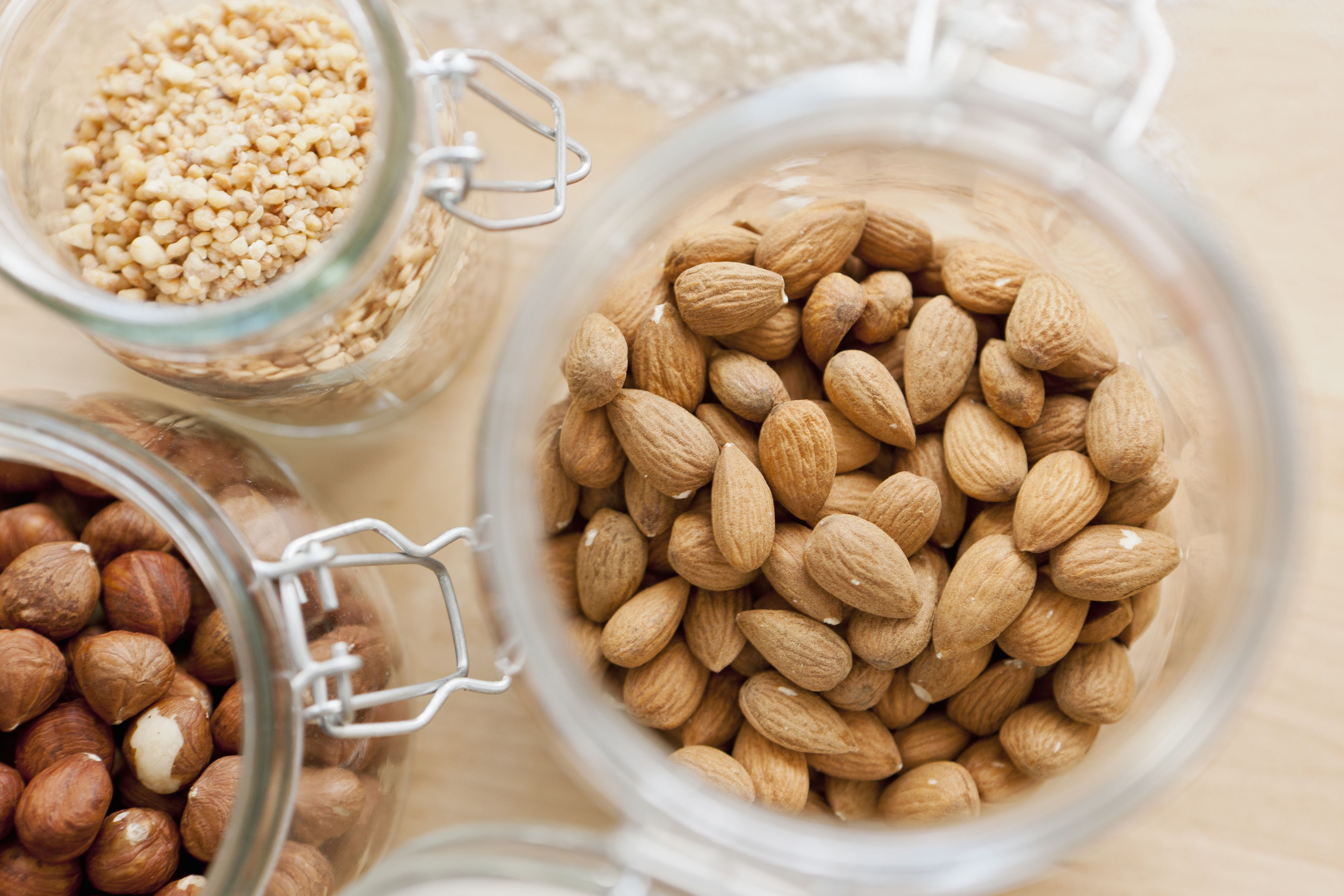 jars of almonds and other nuts