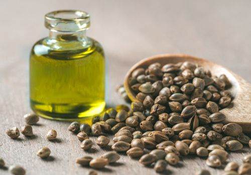 Closeup of hemp seeds and hempseed oil