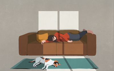 Woman fatigued on couch.