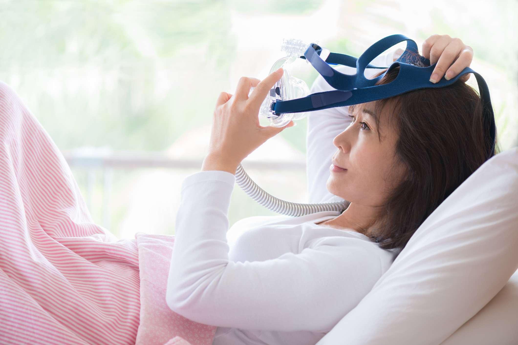 woman with sleep apnea mask