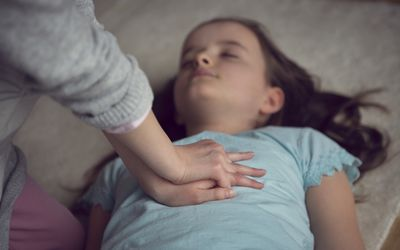 child performing cpr