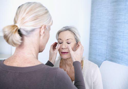 Woman having sinuses examined