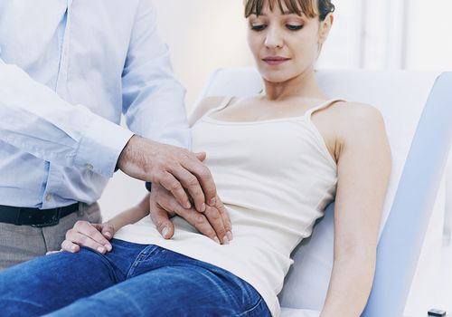 Gastroenterologist checking his patient