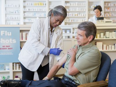 Man getting a shot at a pharmacy