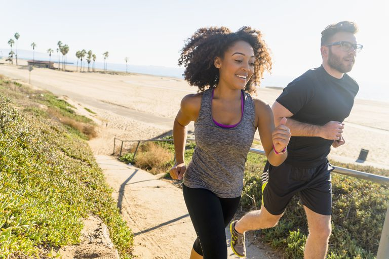 Couple running near beach