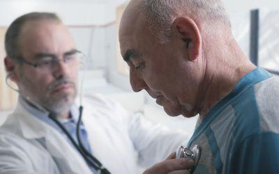 Hispanic doctor examining patient with stethoscope