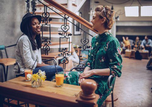 Lesbian couple in coffee shop