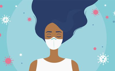 A colorful illustration of a woman of color with a face mask on a blue back ground with COVID-19 virus particles around her.