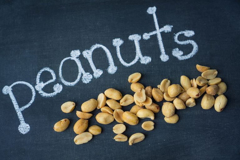 pile of peanuts on a blackboard with the word peanuts written in chalk