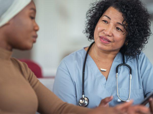 Leukemia patient talks with doctor
