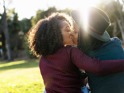 Lesbian couple kissing in the park