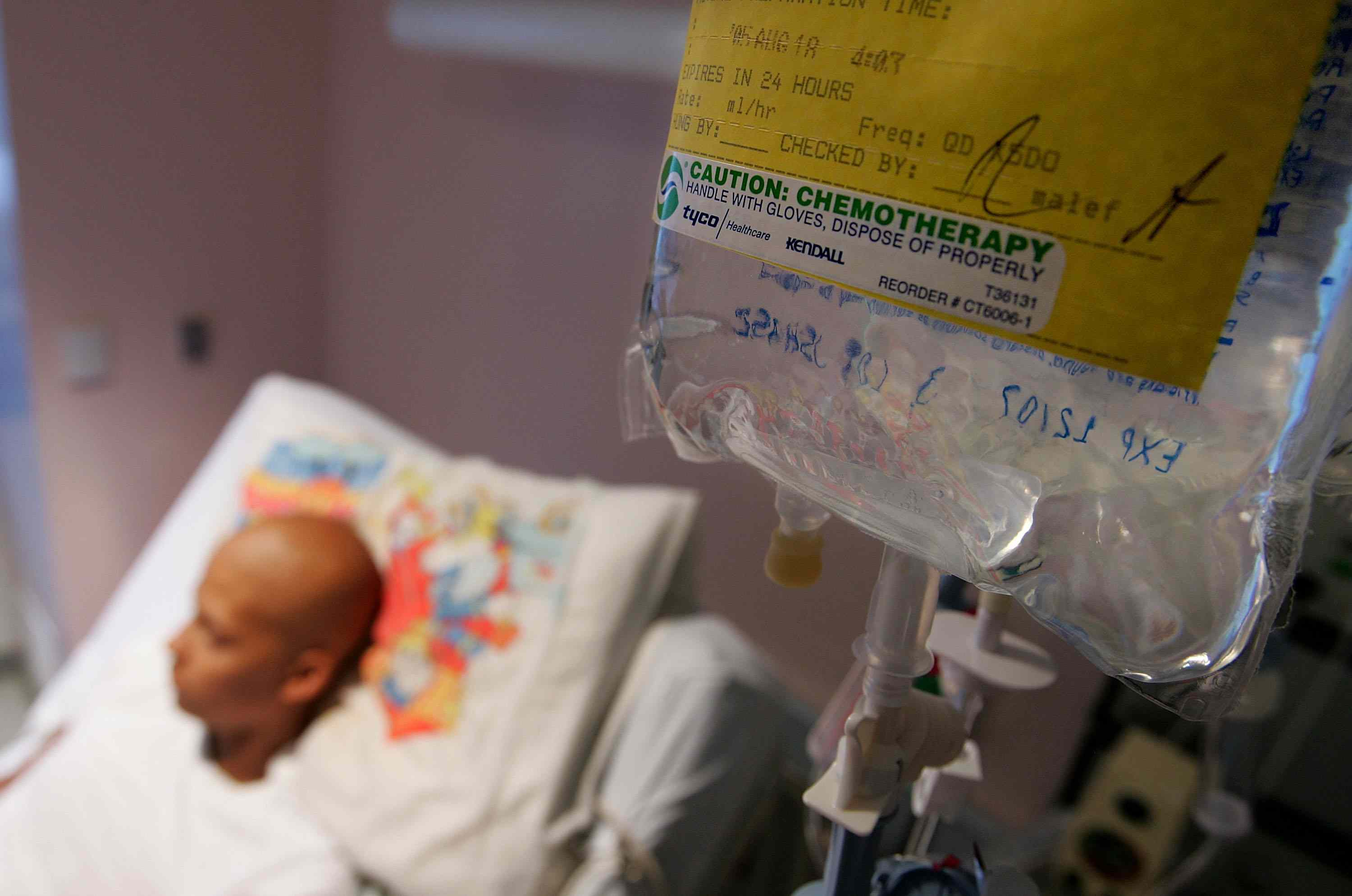Cancer patient in a bed receiving chemotherapy