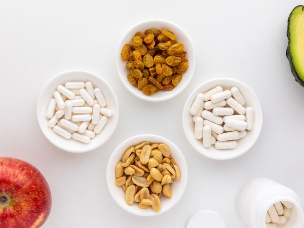 Boron capsules, peanuts, apples, raisins, and avocado