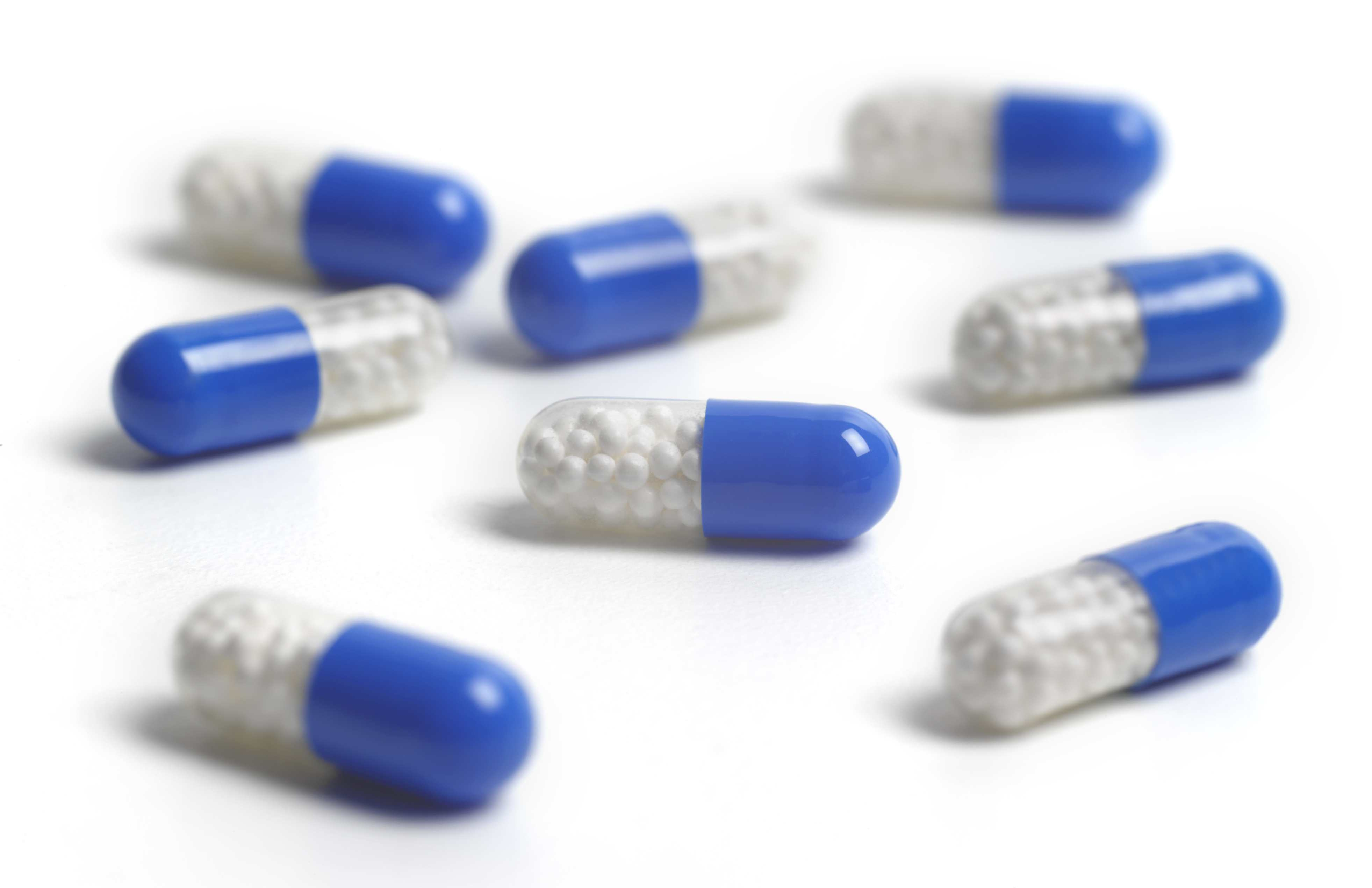Pill capsules laying on a white counter