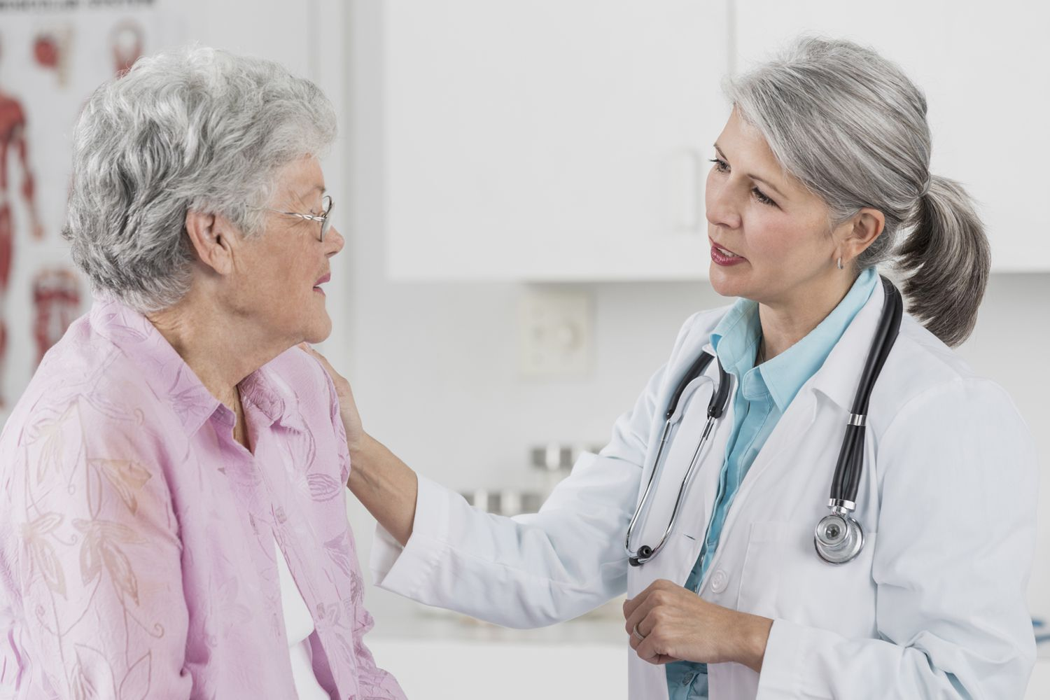 A patient talks with her doctor