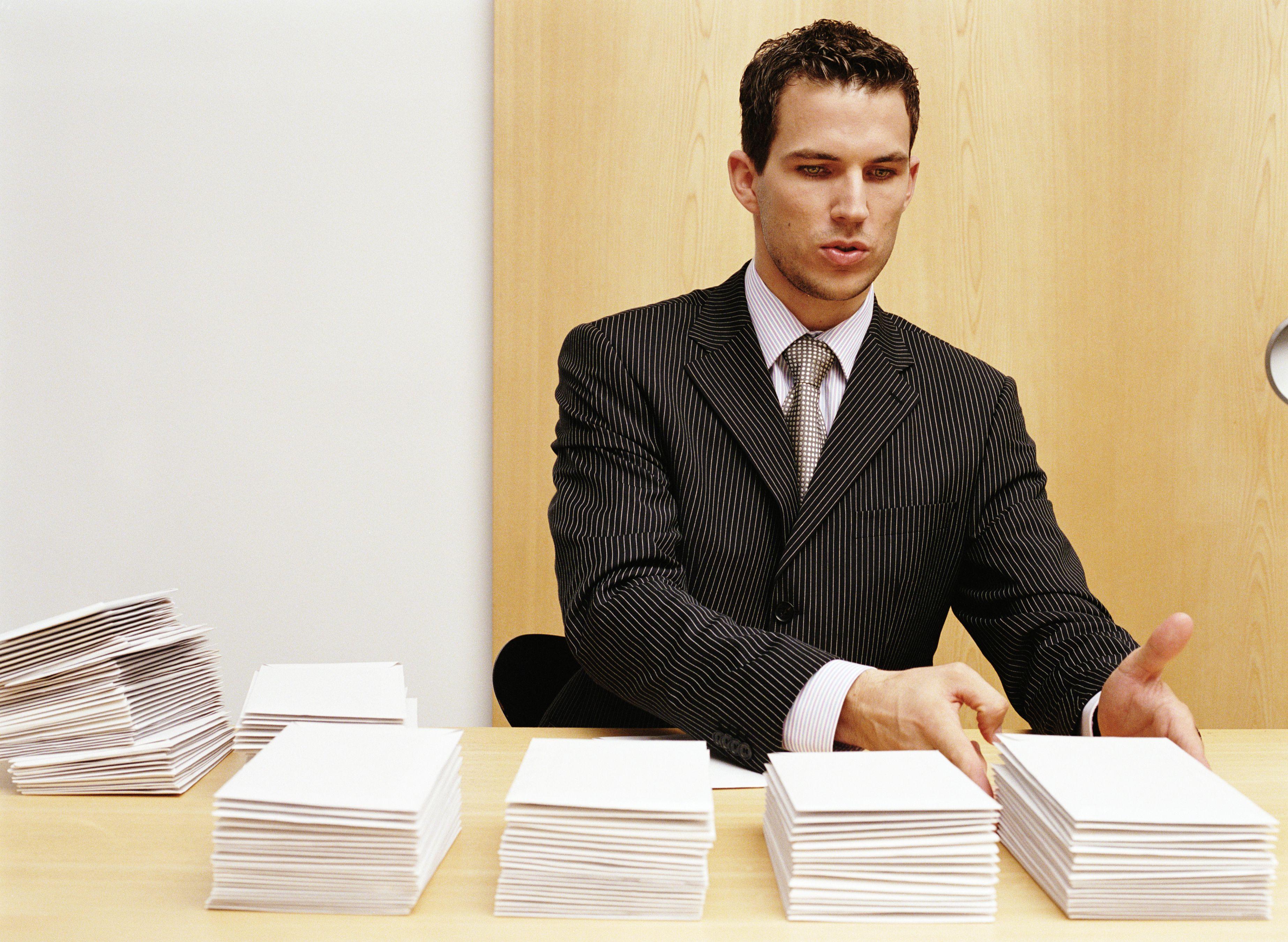 Man stacking envelopes