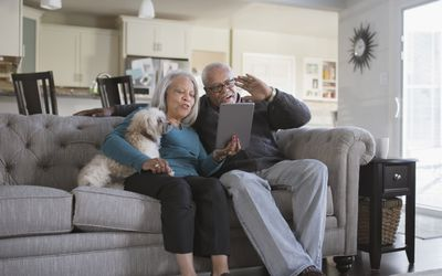 Older couple video chatting with digital tablet