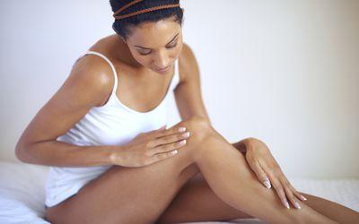 Woman examining her skin