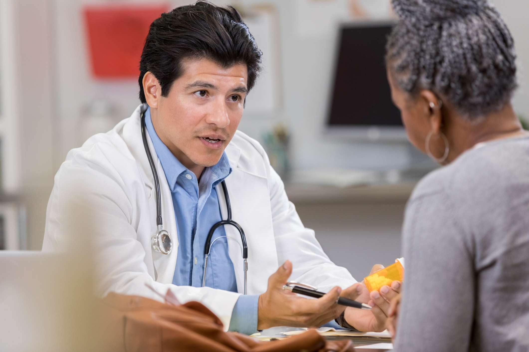 Confident doctor explains new medication to patient