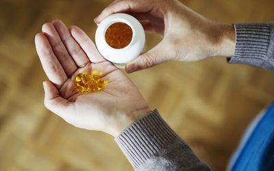 supplements in woman's hand