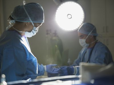 Plastic surgeons performing surgery in operating room