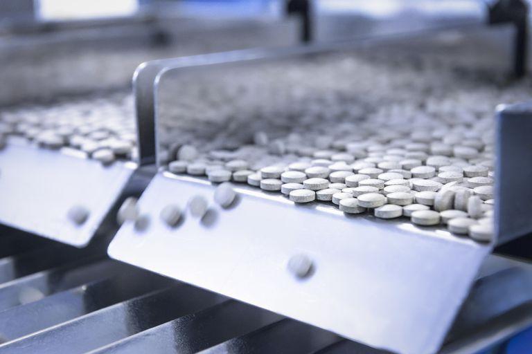 Pills on a conveyor belt