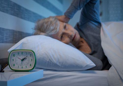 Senior woman awake in bed