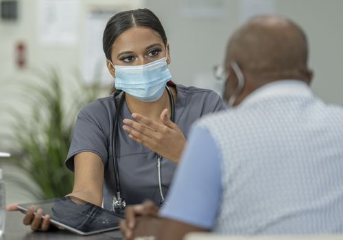 Doctor and patient discuss prognosis