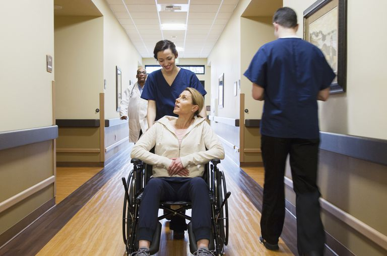 Nurse wheeling patient in hospital