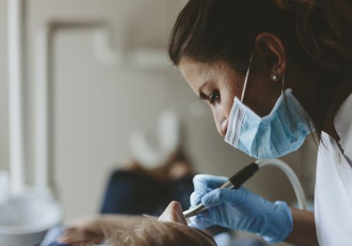 Hygienist performing dental work