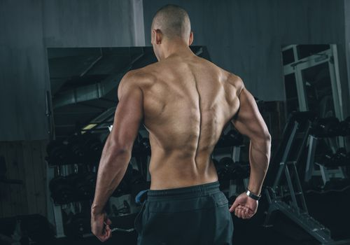 The bent over row builds muscle in the back and shoulders.