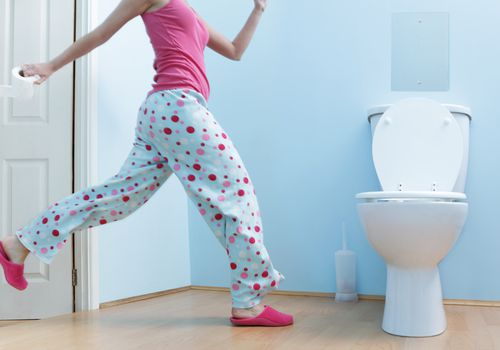 woman running to the bathroom