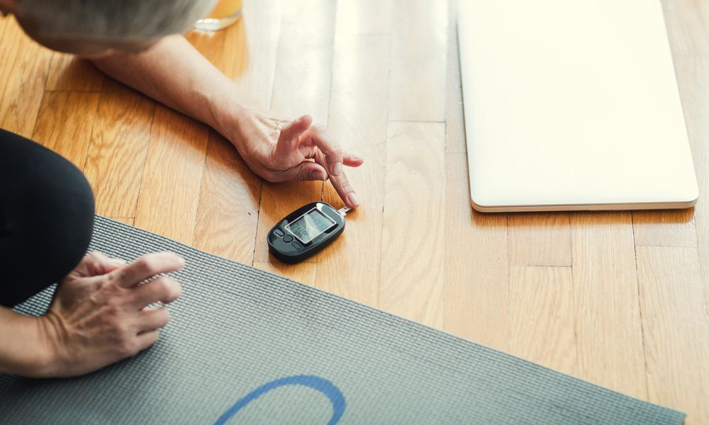 Woman checking her blood sugar after excercise