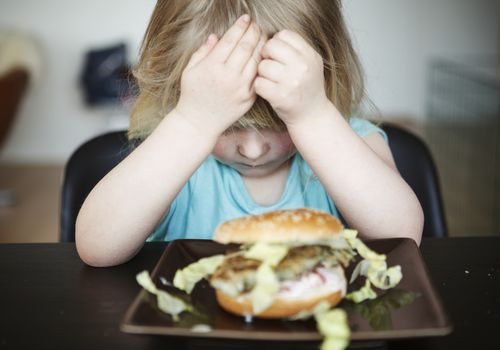upset child with food