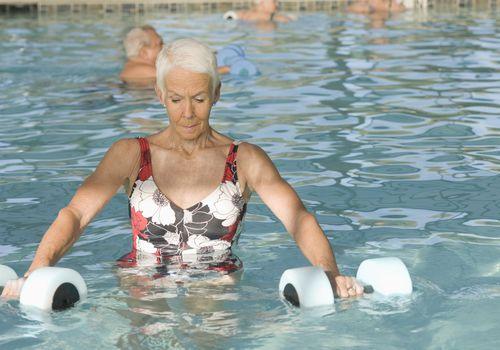 senior woman exercising in swimming pool