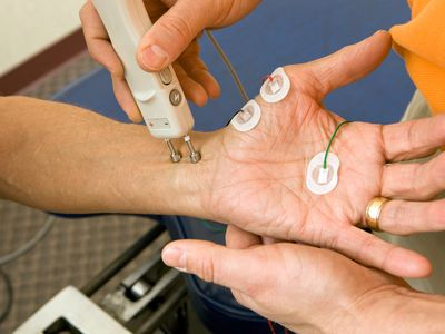 Doctor performing nerve conduction velocity test