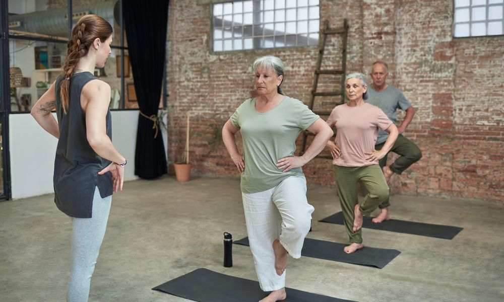 Photo of older people performing balance exercises.