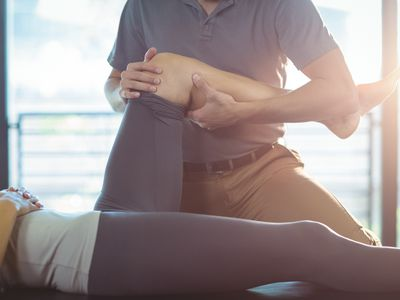 Physical therapist working on woman's leg
