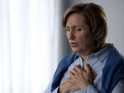a woman having trouble breathing